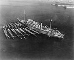 Holland with submarines Cachalot, Dolphin, Barracuda, Bass, Bonita, Nautilus, and Narwhal, 24 Dec 1934