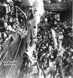Survivors of USS Helena being transferred from destroyer USS Nicholas to cruiser USS Honolulu, Tulagi, Solomon Islands, 7 Jul 1943, photo 2 of 3