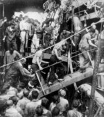 Survivors of USS Helena being transferred from destroyer USS Nicholas to cruiser USS Honolulu, Tulagi, Solomon Islands, 7 Jul 1943, photo 3 of 3