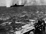 HMS Illustrious under Stuka dive bomber attack in the Mediterranean Sea near Malta, 10 Jan 1941