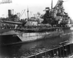 Battleship Indiana at Pearl Harbor Navy Yard, US Territory of Hawaii, 13 Feb 1944, photo 2 of 4; note damage from collision with Washington