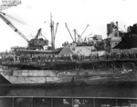 Battleship Indiana at Pearl Harbor Navy Yard, US Territory of Hawaii, 13 Feb 1944, photo 3 of 4; note damage from collision with Washington