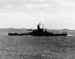 Battleship Indiana underway en route to attack Tokyo, Japan with Task Force 58.1, 12 Feb 1945; note ships of Task Group 58.3 in background