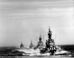 Warships Indiana, Massachusetts, Chicago, and Quincy steaming in a column off Kamaishi, Iwate, Japan, 14 Jul 1945