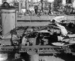 Indianapolis at Mare Island Navy Yard, California, view of her well deck area from port side, with light cruiser Raleigh in background, 19 Apr 1942; note SOC Seagull aircraft onboard