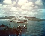 Hospital ship Tranquillity arrived at Guam with survivors of Indianapolis, 8 Aug 1945, photo 1 of 3; destroyer escort Steele in foreground