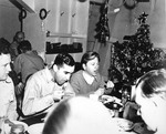 Actor Mickey Rooney eating in the USS Intrepid crews mess during a Christmas visit in California, United States, Dec 1943