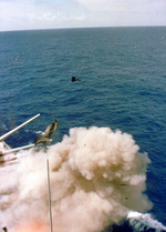 Pieces flying out the No. 2 turret of USS Iowa during the accidental explosion, 19 Apr 1989
