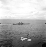 Battleships Iowa and Indiana underway during the Marshall Islands Campaign, 24 Jan 1944; note ships with Camouflage Measure 32 Design 1B and wing of SB2C Helldiver aircraft in foreground
