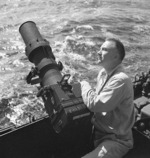 Lieutenant Commander Charles Fenno Jacobs with F-16 camera aboard USS Iowa, Dec 1944