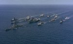 USS Iowa, USS Midway, and other ships of US Navy Battle Group Alpha underway, 1 Dec 1987