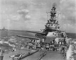Forward guns and superstructure of USS Iowa underway during the Marshall Islands Campaign alongside USS Indiana, 24 Jan 1944.