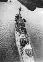 German light cruiser Köln underway in confined waters, circa 1930, photo 1 of 2; note off-centerline positioning of turrets