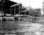 Koryu Type D submarines in an assembly shed at the Mitsubishi shipyard, Nagasaki, Japan, circa Sep 1945, photo 1 of 2
