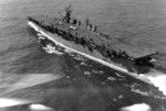 USS Langley underway off Cape Henry, Virginia, United States, 6 Oct 1943; note SNJ aircraft on flight deck