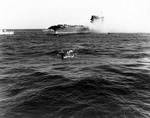 A whaleboat evacuating men from USS Lexington, 8 May 1942, photo 1 of 2