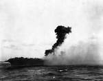 Explosion amidships aboard USS Lexington, 1727 on 8 May 1942, photo 1 of 3