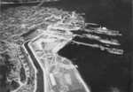 Aerial view of Puget Sound Naval Shipyard, Bremerton, Washington, United States with the Manette Bridge over the Port Washington Narrows in the background, 1932.