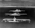 USS Ranger (foreground), USS Lexington (center), and USS Saratoga (background) at anchor off Honolulu, US Territory of Hawaii, 8 Apr 1936