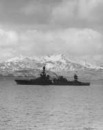 Louisville steamed out of Kulak Bay, Adak, Aleutian Islands, bound for operations against Attu, 25 Apr 1943; note Sweepers Cove in background