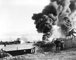 Tugs and other craft tried to put out fires on LST-480 resulted from an explosion from the previous day, Pearl Harbor, 22 May 1944
