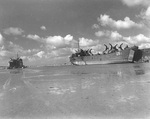 LST-1 (right) and LST-292 high and dry on the beach at Saint-Michel-en-Greves in the Brittany region of France, Sep 1944