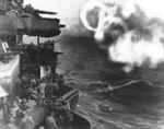 Minneapolis bombarding Butaritari Island, Makin Atoll, Gilbert Islands with her 5-in secondary guns, 20 Nov 1943; note rings of smoke