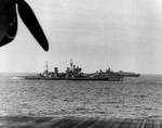 HMS King George V, USS Missouri, a British destroyer, and an American Essex-class carrier at sea off Japan, 16 Aug 1945