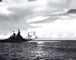 Missouri firing full salvo from both forward 16-inch gun turrets during shakedown exercise, Aug 1944; note six super-sonic projectiles at upper right; as seen on page 23 of US Navy War Photographs