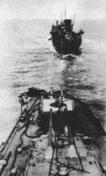 Mogami with damaged bow, Pacific Ocean, 6 Jun 1942; note tanker Nichiei Maru in background
