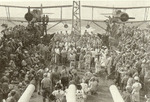 Line crossing ceremony aboard light cruiser USS Montpelier, circa 30 Dec 1942; note SOC-1 aircraft in background