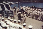 US Navy Rear Admiral Aaron S. Merrill receiving the Navy Cross award from Vice Admiral Aubrey W. Fitch on the after deck of USS Montpelier, Tulagi Harbor, Solomon Islands, 11 Dec 1943