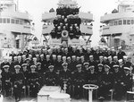 Officers and crew of destroyer Mugford, with Lieutenant Commander Arleigh A. Burke in center, circa 1939-1940