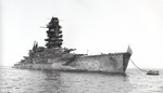 Battleship Nagato at Yokosuka, Japan, 1946; note heavily damaged superstructure and the American flag at bow