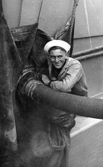 A sailor fueling USS New Mexico, circa 1919