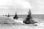 US Navy Task Group 38.3 entering Ulithi anchorage in a column following strikes in Philippine Islands, 24 Dec 1944, photo 7 of 7
