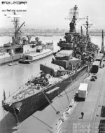 Cruiser Pensacola at end of her final overhaul, with circles marking alterations to the ship, Mare Island Navy Yard, California, United States, 3 Jul 1945; note cruiser Indianapolis and lighter YF-390