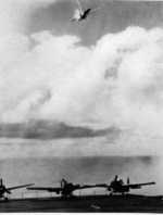 Flaming special attack plane falling astern of Petrof Bay, Philippine Islands, 26 Oct 1944
