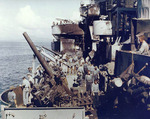 Crew of USS Nashville inspecting the damage caused by a special attack aircraft, Dec 1944