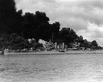 Phoenix steaming past burning wrecks of battleships West Virginia and Arizona, Pearl Harbor, US Territory of Hawaii, 7 Dec 1941