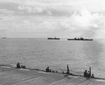 Cruiser Phoenix screening escort carriers off Leyte, Philippine Islands, 30 Oct 1944