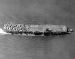 Light Carrier USS Princeton with a deck full of aircraft on her shakedown cruise, 31 May 1943 off Antigua. Photo 1 of 4