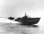PT-105 and two other torpedo boats of US Navy Motor Torpedo Boat Squadron Five running at high speed during exercises off the US east coast, 12 Jul 1942