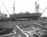 PT-109 stowed on board the Liberty Ship Joseph Stanton for transportation to the Pacific Ocean, Norfolk Navy Yard, Virginia, United States, 20 Aug 1942, photo 1 of 2