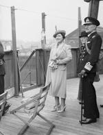 Queen Elizabeth and Vice Admiral J. A. G. Troup on the bridge of RMS Queen Mary on the River Clyde, Scotland, United Kingdom, 4 Jun 1942