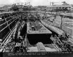 Submarines R-1, R-2, R-3, R-4, R-5, R-7, R-8, and R-10 in Dry Dock #2 of Mare Island Naval Shipyard, California, United States, 8 May to 10 Jun 1922