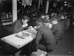 View of the mess hall aboard HMS Rodney during tea time, 1940