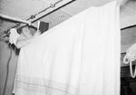 A sailor in his bunk aboard HMS Rodney, 1940