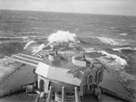 View of the forward section of HMS Rodney while underway at sea, date unknown
