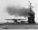 US Navy TDN-1 drone test from the decks of the training carrier USS Sable while steaming in reverse in Grand Traverse Bay, Michigan, United States, 10 Aug 1943. This particular test was unsuccessful. Photo 1 of 4.